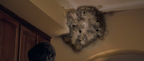 I don't think that's supernatural. Looks more like a bad case of swallows building nests in their house...
