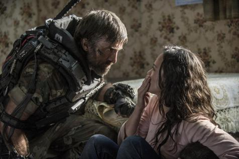 Elysium - Sharlto Copley and Alice Braga