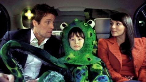 Love Actually - Hugh Grant, some kid, and Martine McCutcheon
